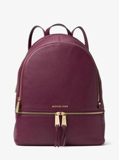 Laid-back yet luxe, our Rhea backpack redefines big-city accessorizing. We love the juxtaposition of supple Venus leather against the high-shine hardware. With its multiple zipper pockets, designed to stow a laptop, wallet and more, it's a feminine take on an enduring design.