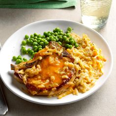 Pork Chop Potato Dinner Recipe -Tender chops cook on a bed of creamy potatoes in this all-in-one meal. It's a snap to assemble, thanks to frozen hash browns, canned soup, shredded cheese and french-fried onions Crock Pot Slow Cooker, Crock Pot Cooking, Slow Cooker Recipes, Crockpot Recipes, Cooking Recipes, Freezer Cooking, Potato Recipes, Pork Recipes, Slow Cooker