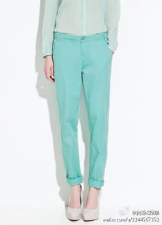 Mint sheer blouse, mint trousers and nude heels.