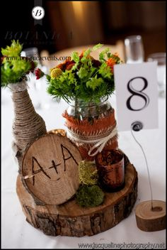 Rustic centerpieces with bottles and jars