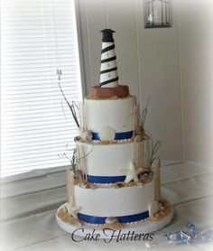 Cape Hatteras Lighthouse Wedding Cake by Donna Tokazowski- Cake Hatteras Hatteras N.C.  - http://cakesdecor.com/cakes/250256-cape-hatteras-lighthouse-wedding-cake