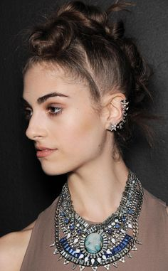 For the boxing meets ballerina theme, hairstylist Sarah Potempa created faux Mohawks by layering buns.