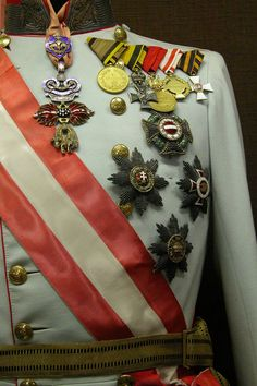Kaiser Franz Joseph's gala uniform with his military orders, decorations and medals.  The highest order is the Order of the Golden Fleece, which is suspended from the collar..