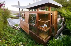 Not sure if this is a tree house or a house on stilts surrounded by trees, but I like it. A lot! Especially the way the windows open.     Google Image Result for http://blog.2modern.com/wp-content/uploads/2010/10/6a00d834522c5069e20133ec7caa46970b-500wi.jpg