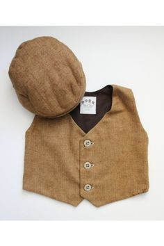 Classic vest created from super soft tan and brown herringbone 100% brushed cotton fabric. Fully lined and backed with coordinating brown cotton. Three to four buttons on front (depending on size). Matching hat available to rent separately.