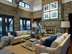 A fabulous great room with stone walls, a cream and navy color palette and a contemporary fireplace provides a relaxing place to entertain and enjoy time with friends and family.
