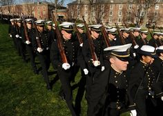 The Coast Guard Academy corp of cadets march onto the Washington Parade Ground for the regimental review in honor of the Coast Guard Foundation Friday, March 30, 2012. The review was the first of seven scheduled for the spring.