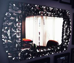 I stayed at a place in Paris that had a big, funky mirror like this. This one is from designer Sasha Pytka's house.