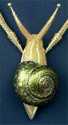 "John Paul Miller snail necklace. John Paul Miller revived the ancient technique of ""granulation"" — embellishing a gold surface with infinitesimal spheres of gold."