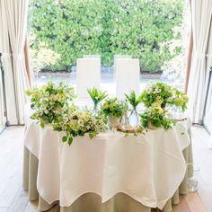 *♡*Wedding Report 62*♡* * 高砂装花の全体像です✨ * 薄い色のグリーンと白い小花とマトリカリアでお願いして、ビンとか切り株とか使って細々と並べてください✨ そして、入荷したら絶対スズラン入れてください✨っていうわがままなオーダーをしました☺️ * 無事スズランもはいって、細部にお花屋さんのセンスが宿る、めっちゃめっちゃ可愛い装花でした✨ * * * #wedding #ガーデン挙式 #ガーデンウエディング #レストランウエディング #メゾンドタカ芦屋 #高砂 #高砂装花 #装花 #メインテーブル #メインテーブル装花 #flowers #小花 #お花大好き #お花 #グリーン #weddingphotography #weddingreport #卒花 #卒花嫁