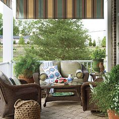 Style Guide: 61 Breezy Porches and Patios | Cozy Side Porch | SouthernLiving.com