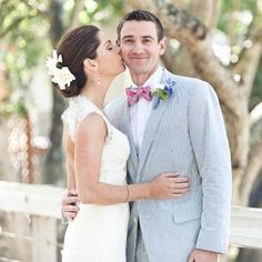 A lightweight seersucker suit, accessorized with a pastel bow tie, is a refreshing choice for spring.  [Photo Credit: Allyson Wiley Photography] #belltowerchapel, #belltowerchapelftw, #Belltowergarden, #bestweddingvenue, #chapelftw, #choosingweddingvenue, #engagement, #engagementrings, #weddinggown, #weddinghour, #weddingring, #weddingshoes, #weddingvenue, #weddingvenueoptions, #weddingstyle #groom #tuxedo #springwedding #springcolors