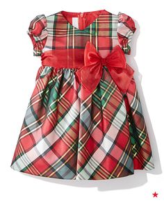 Bow-ed over! This baby girl's dress makes for an adorable holiday card outfit.
