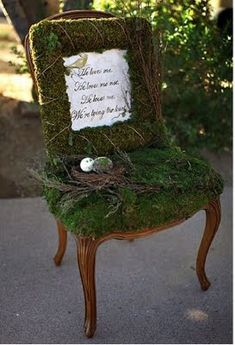 an old chair that is no longer usable would look fantastic tucked in the garden with a moss seat, maybe a pot of seasonal flowers...