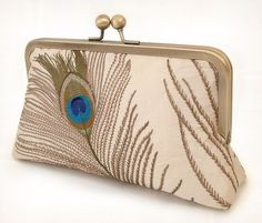 silk peacock feathers  luxury clutch bag by redrubyrose on Etsy, $125.00 -  RedRubyRose makes some of the most beautiful clutches on Etsy! I covet almost every single one of them!