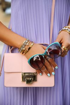 Purple pleated dress + Jimmy Choo bag.