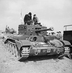 Winston Churchill inspects a Cromwell MK-IV Tank of the #2 squadron 2nd armored battalion at Pickering in Yorkshire March 31 1944.