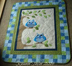 http://rhianontaylor.blogspot.com/p/babychildrens-quilts.html