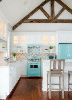 Lovely bright beach house kitchen - white and turqouise cobmination with wooden details