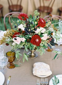 Family style dinner at long banquet tables adorned with vintage glassware and wildflowers.  Ojai, California Wedding from Tec Petaja & Bash, Please    Wedding Design, Coordination, Paper + Floral Design: Bash, Please /