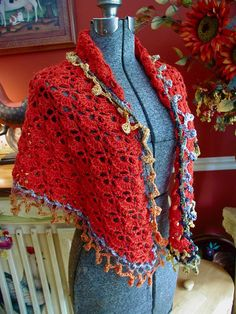 Shawl Free Crochet Pattern:  This site has a link to the Lionbrand Free Pattern-I pinned this site instead of Lion because you must log into Lion to get the pattern, AND the sample on the Lion's site is OOGLY, but this is a cute variation on the same pattern.