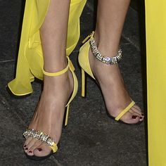 Selena Gomez wearing yellow Calvin Klein 'Camelle' sandals with mismatched jeweled straps. Extreme High Heels, Sexy High Heels, Womens High Heels, Selena Gomez Shoes, Yellow Sandals, Leather Mini Dress, Sparkly Heels, Dress With Sneakers, Celebrity Feet