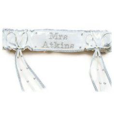 Silver and white satin personalised wedding diamante garter embroidered with the brides name.