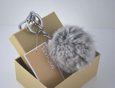 MICHAEL KORS Fur Pompom Keychain in Silver with Gift Box