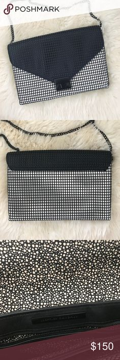 Loeffler Randall Rubberized Windowpane Lock Bag •Black and white leather lock clutch with a black chain cross body strap.  Rubberized mesh windowpane overlay. Height: 6.75in, Length: 10.75in, Depth: 1.5in, Strap drop: 22.75in / 58cm.  •Like new condition.   •No trades, no PayPal. Loeffler Randall Bags Crossbody Bags