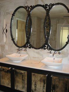 Vintage triple oval mirror painted black and vintage credenza re-purposed as a bathroom vanity- antiqued mirror panels added.