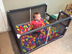 Ball pit from PVC pipe. Plastic fencing attached with zip ties and covered with pipe insulation. $70 total from Lowes. We made a U shape cutout on one side for a slide.