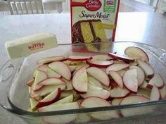 FRESH APPLE CAKE -  Abt 5-7 granny smith apples (or whatever you prefer), peeled, cored & thinly sliced 1 (9 oz) package yellow cake mix 2 T sugar 1 T ground cinnamon 1 stick real butter Directions: 1. Preheat oven to 350°F. 2. Cut apple slices crosswise in half. 3. Place in pan; sprinkle with dry cake mix. 4. In small bowl, combine sugar & cinnamon; sprinkle over cake mix. 5. Drizzle with butter. 6. Bake 30 minutes or until topping is golden brown. 7. Serve warm with ice cream, if desired!