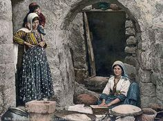 Here we present a dramatic image of Syrian peasant making bread. This color photochrome print was taken between 1890 and 1900.