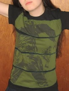 t-shirt upcycle [i found part of a pattern at the free store that I fell in love with...I will probably do somethign similar to this.]