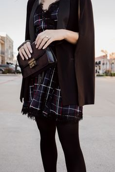 452ad3a31d7 Houston fashion blogger Uptown with Elly Brown wears a plaid dress with a  tuxedo cape