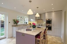 """This is our Handmade in-frame shaker kitchen in blackened. A very attractive kitchen, with """"Ivory Fantasy"""" granite worktops. I think the contrast between the Farrow & Ball """"Blackened"""" on the main furniture and the """"Brassica"""" on the island is great."""