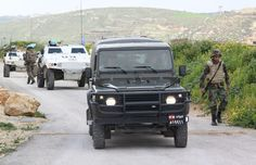 A Lebanese Army Land Rover Defender 90 pickup of the 12th Mechanized Brigade and UNIFIL FrenchBatt VBL vehicles, March 16, 2012.