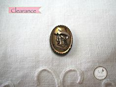 SAVE 10% use coupon code PIN10 CLEARANCE MARKED DOWN FROM $2.00/$1.80.  Vintage oval glass cameo with serrated edges and copper embossed gladiator, unused from about 1950 in excellent condition.   Quanti... #supplies #bead #cabochon