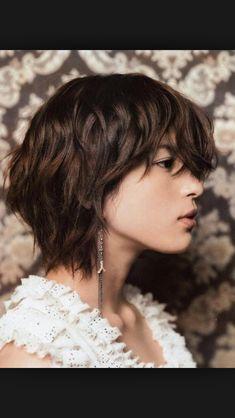 Short layer hair cut.