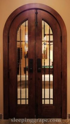 Solid Maple wine cellar door weighing in at 450 lbs.