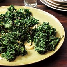Roasting kale is amazing—the leaves turn from a dusty dark green to dark emerald with brown-tinged curly edges that crunch. This vegetable side is delicious served hot from the oven; the leaves lose their crisp texture as the dish stands.