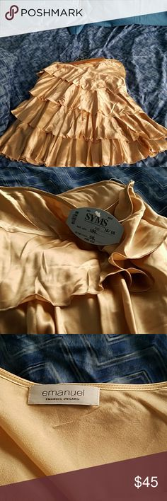 Emanuel Unharo silk tiered skirt, brand new, tags Pure silk skirt, brand new, Emanuel Ungaro, color I would describe as coffee gold, great for holidays. Emanuel Ungaro Skirts A-Line or Full