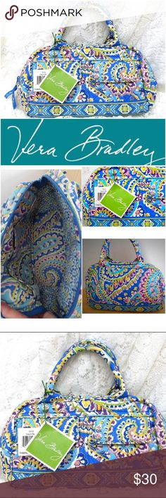 "NWT Vera Bradley Lola Capri Blue Baby Bowler Bag SGW13 - NWT Vera Bradley Lola Capri Blue Baby Bowler - LOLA - Zip around top closure with Vera Bradley logo ribbon zipper pulls - Two front pockets with magnetic snap closure - removable interior bottom board for support - interior back wall has 3 slip compartments - Measurements are 11"" x 6 3/4"" x 11 1/4"" and the double straps drop 4"" - Retail 63.00 Vera Bradley Bags"