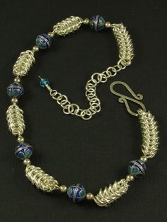 Box Chain and Blue Beads Necklace -  Strips of sterling silver Box chain joined with10mm cobalt and turquoise colored enameled  beads. Handmade clasp with a  crystal donut bead dangling from the catch. Adjustable from 14.5 to 18 inches long.