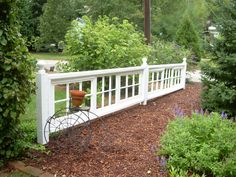 My fence of old window sashes! Here's an idea for all those windows we have laying around honey!