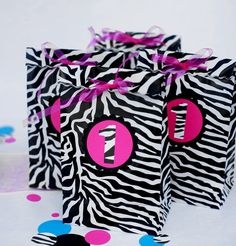 ZEBRA favor bags ONE DOZEN zebra print by missdaisyw on Etsy, $18.00  More less may be purchased.  Any number or letter may be used to customize bag.  Pink may be changed to color of choice.