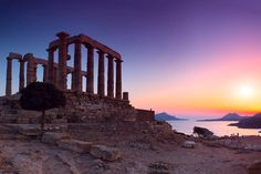 Temple of Poseidon at Sunset, Sounion, Greece.  Go to www.YourTravelVideos.com or just click on photo for home videos and much more on sites like this.