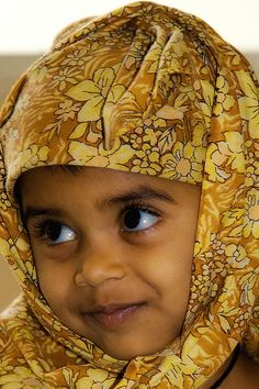 A precious little girl from India. This is the cutest, most beautiful thing I've ever seen! She's absolutely precious! Her big eyes!