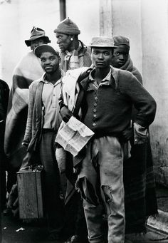 Pensive tribesmen, newly recruited to work in mining, await processing and assignment. South Africa, Photo by Ernest Cole, c.1960-66
