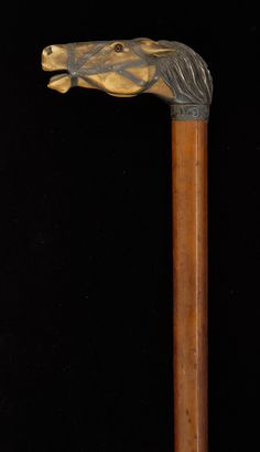 Carved bone and silver horse head cane...............great for a display, conversation piece